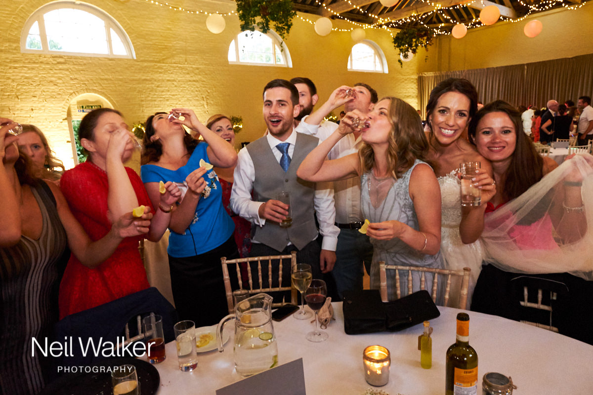guests drinking shots at a wedding