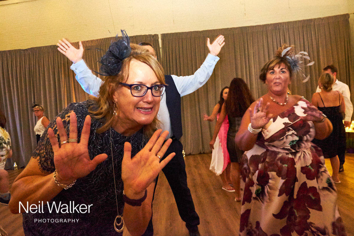 a guest waving at the camera at a Sussex wedding