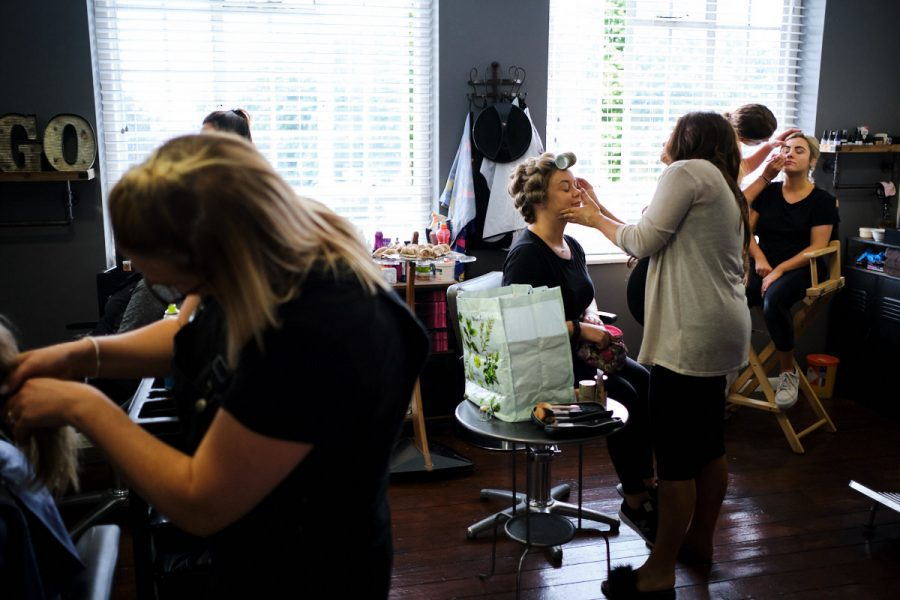 a bride having her hair and makeup done before her wedding in Sussex