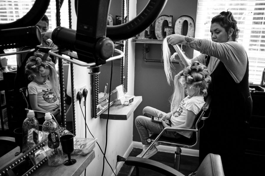 A flower girl at a Sussex wedding having her hair done.