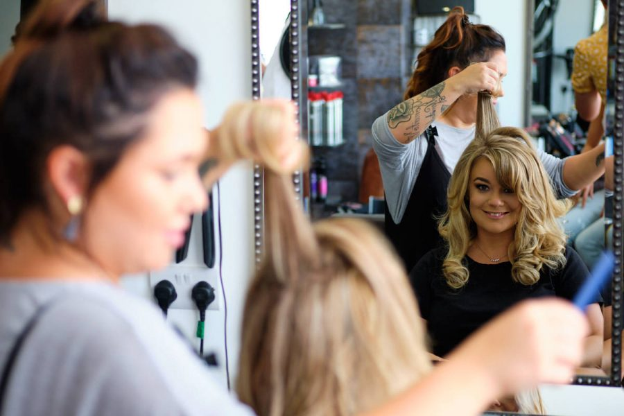 The bride having hair and makeup before her summer Sussex wedding.