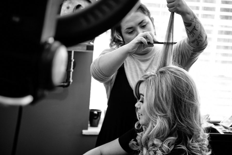 The bride having her hair done.