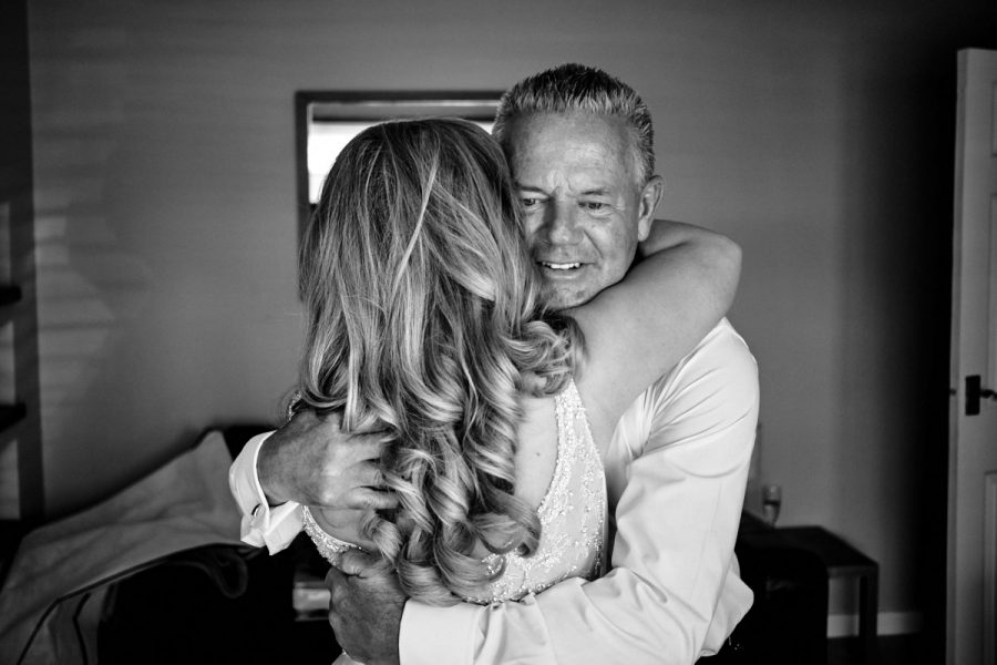 The bride hugging her father before the wedding.