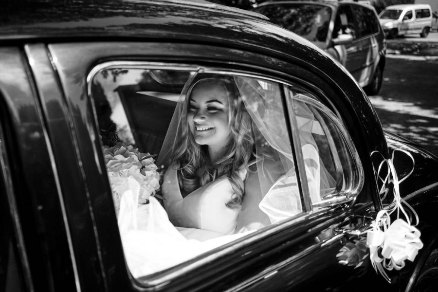 The bride arriving at the church in the wedding car.