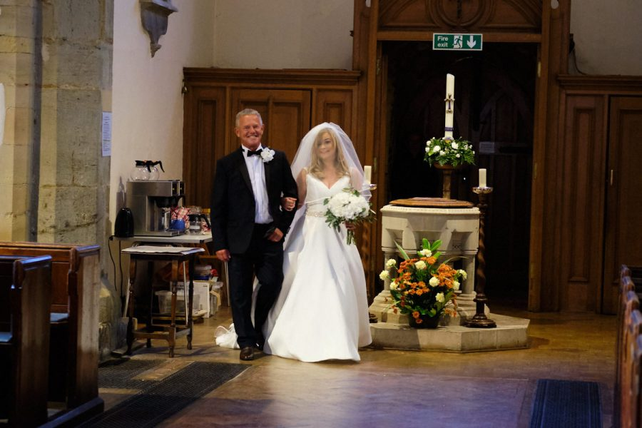 The bride and her father entering the church.