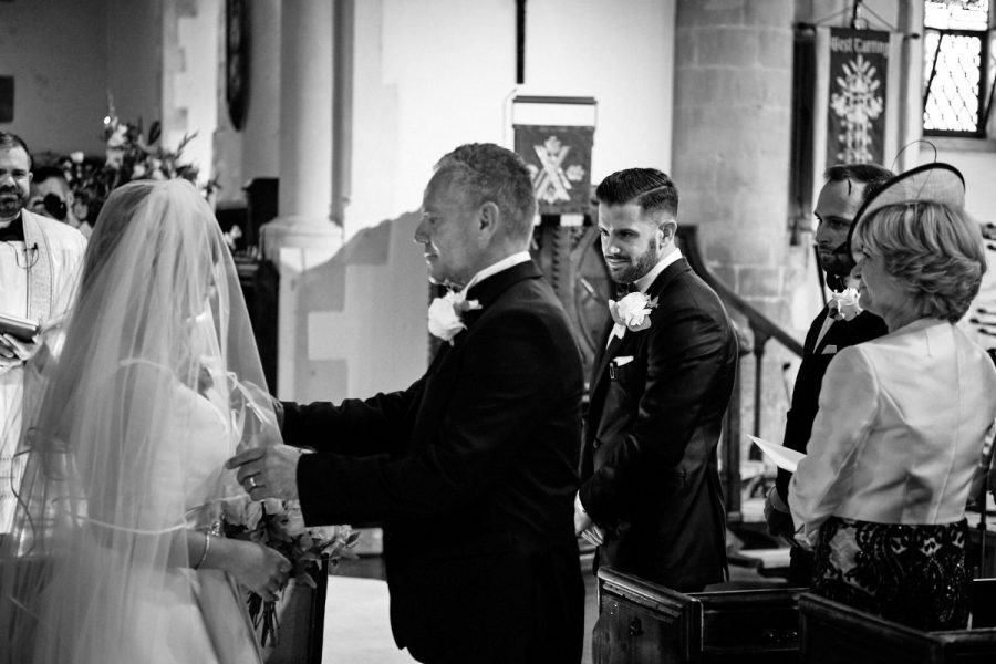 The groom seeing the bride for the first time on their wedding day.