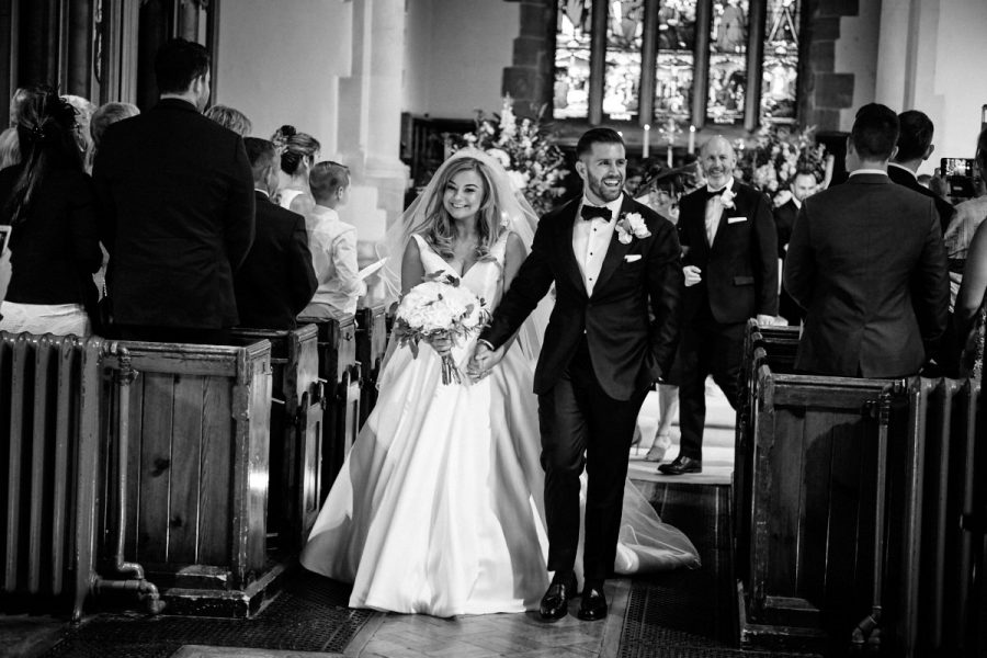 The bride and groom walking down the aisle.