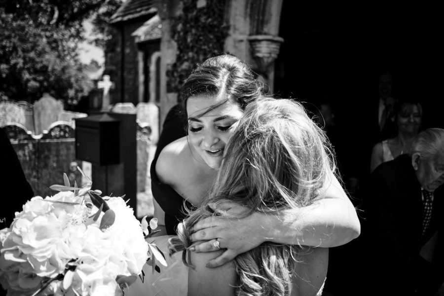 The best woman congratulating the bride.