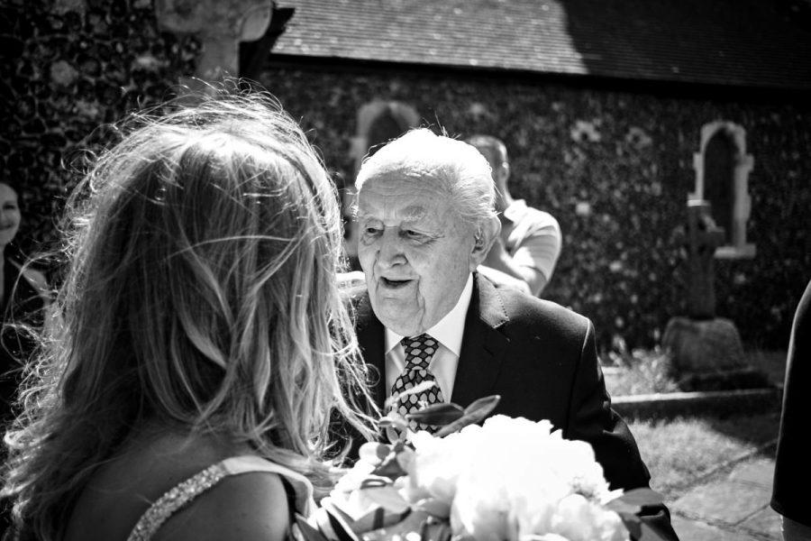 Grandfather of the groom congratulating the bride.