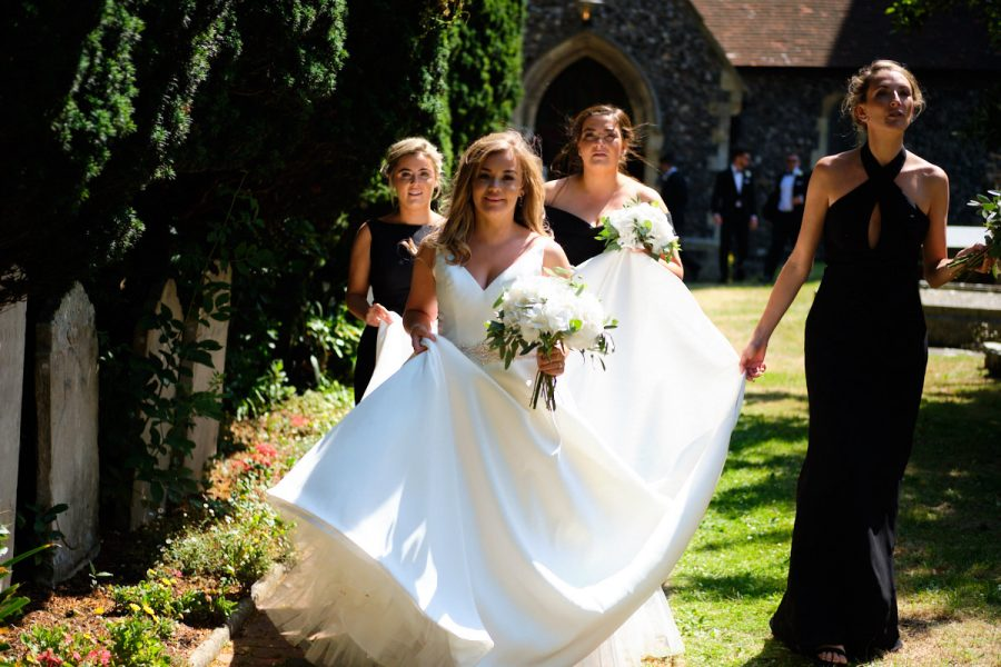 The bride leaving the church at a Sussex wedding.