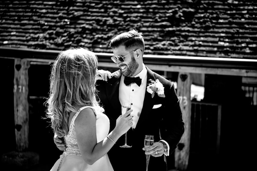 The bride and groom sharing a moment at their summer wedding at Cissbury barns.
