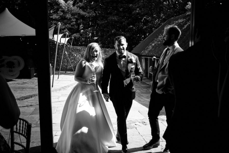 The happy couple making their entrance to the wedding breakfast.