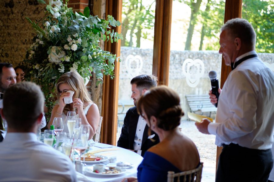 A bride crying during her father's speech.
