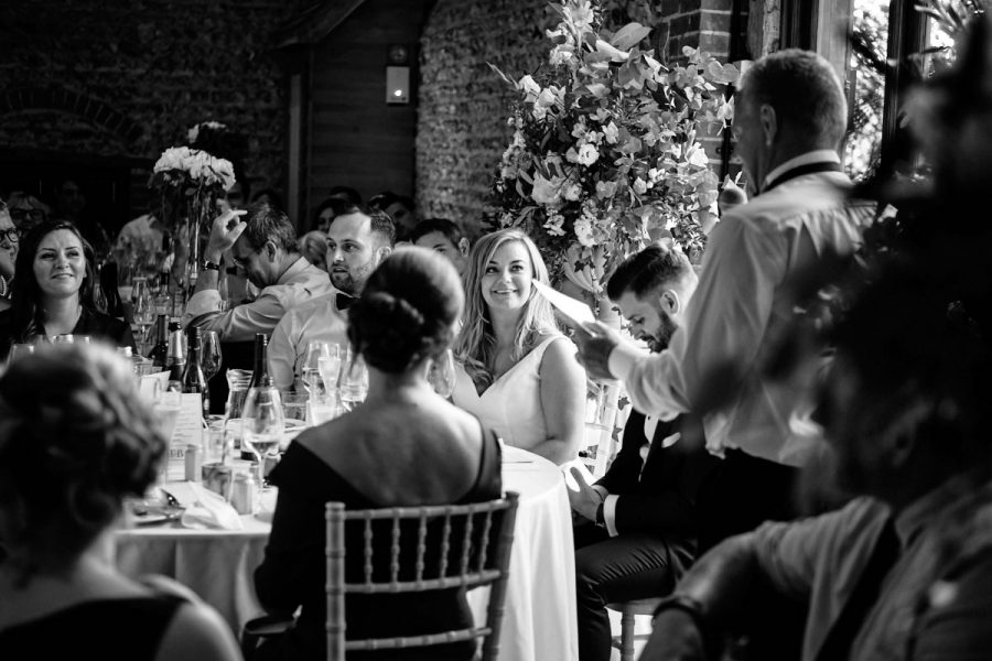 The bride watching her father doing the father of the bride speech.