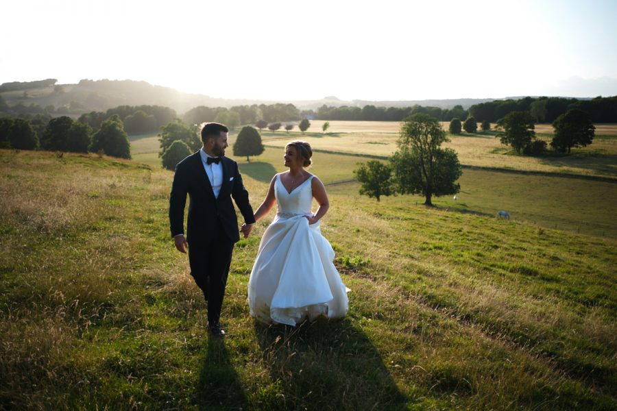 A bride and groom in the beautiful evening light in Sussex, photographed by Cissbury Barns wedding photographer Neil Walker.