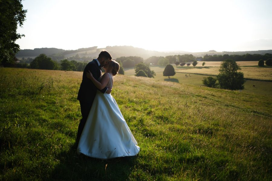 The bride and groom in the evening light at Cissbury Barns in Sussex.