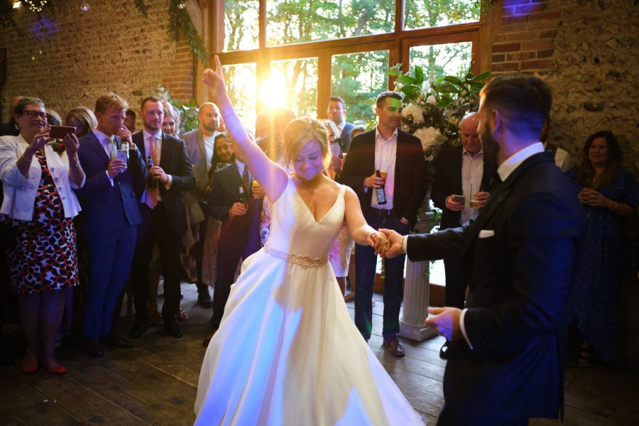 The bride and groom's first dance at a wedding at Cissbury Barns.