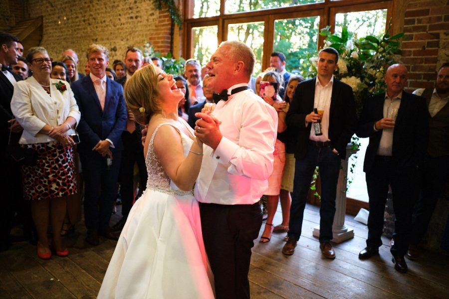 Father and daughter dance at a wedding at Cissbury Barns.