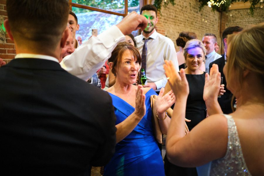 The bride's mother dancing at her wedding in Sussex.