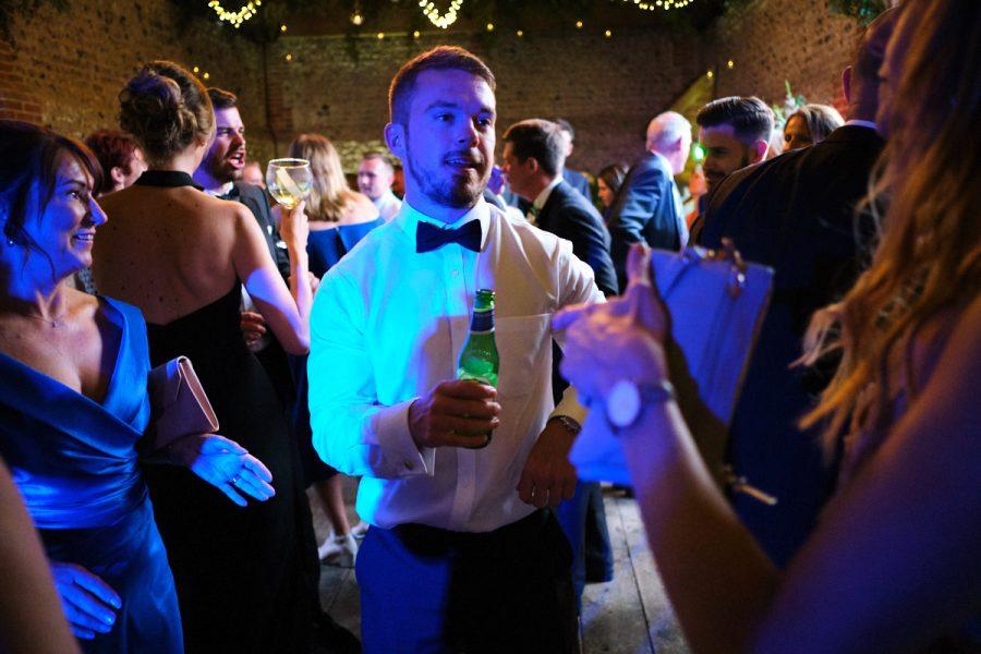A guest dancing at a wedding