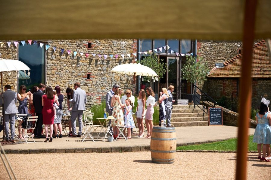 Wedding guests in front of Grittenham Barn