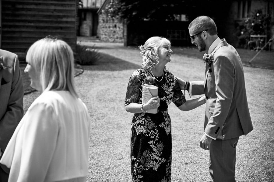 The groom at his wedding, with his mother sharing a moment before the ceremony