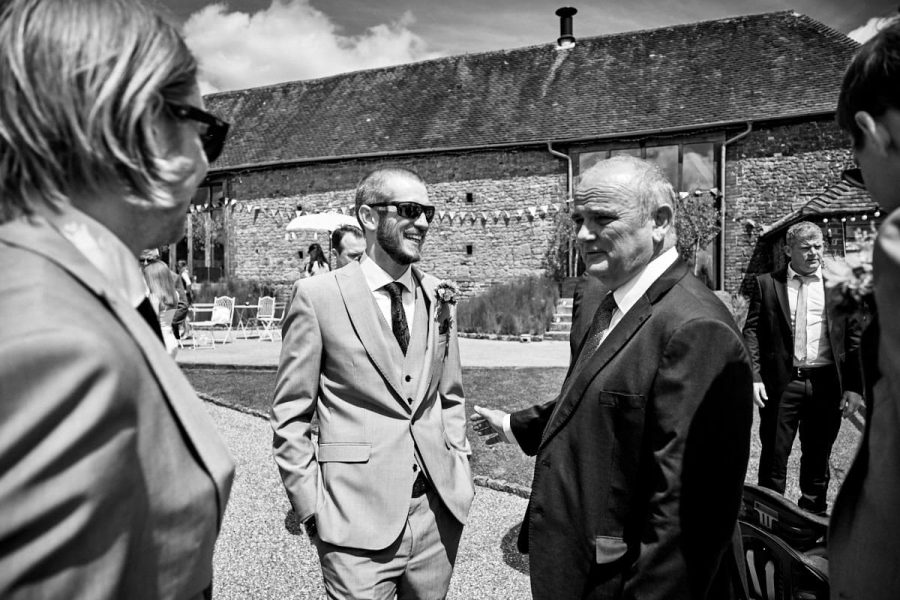 The groom greeting guests