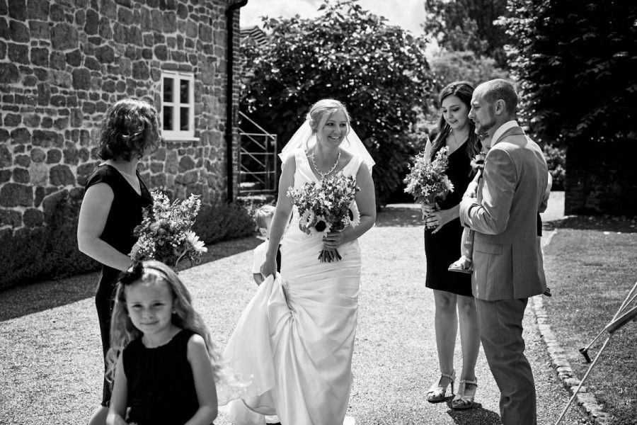 The bride getting ready to go to the ceremony room at Grittenham Barn