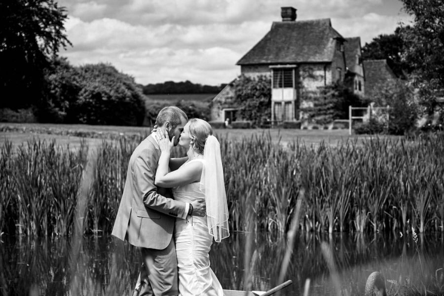 The bride and groom kissing at their wedding at Grittenham Barn in Sussex
