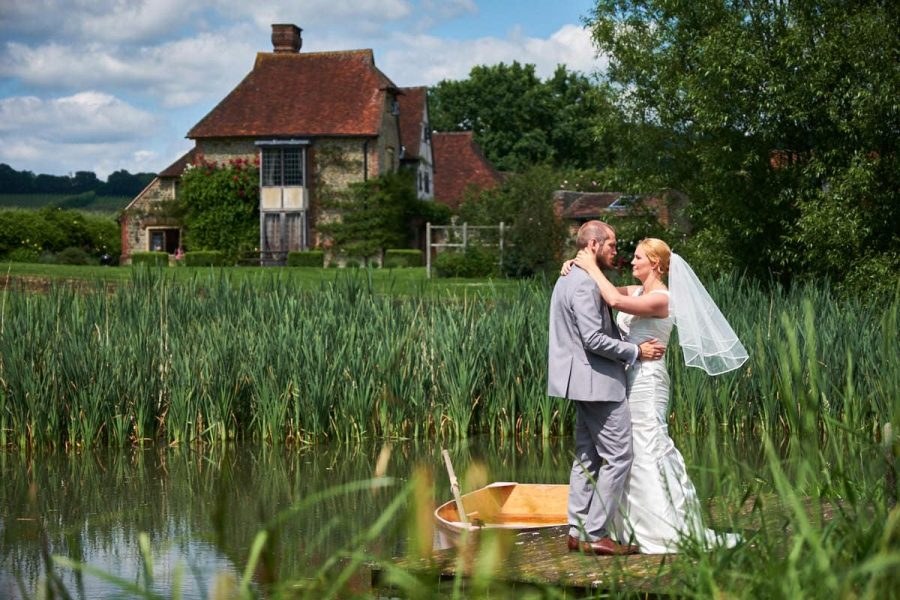 A bride and groom at their summer wedding at Grittenham Barn in Sussex