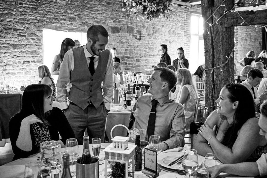 The groom talks to guests