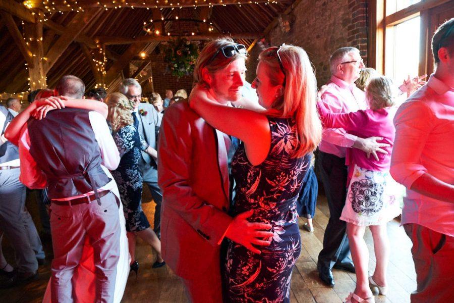 Guests at a wedding at Grittenham Barn dancing