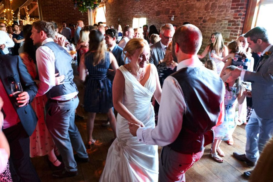 The bride and groom at their wedding at Grittenham Barn dancing