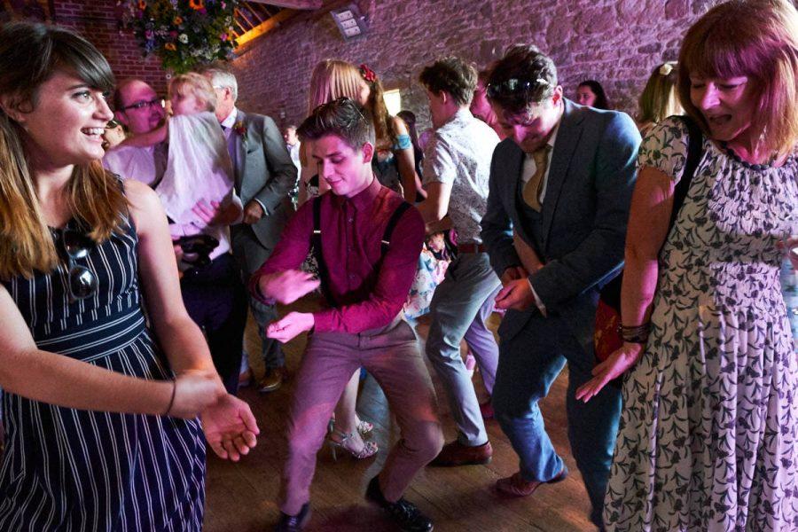 Guests at a wedding at Grittenham Barn dancing together