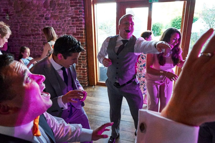 Guests at a wedding dancing and singing