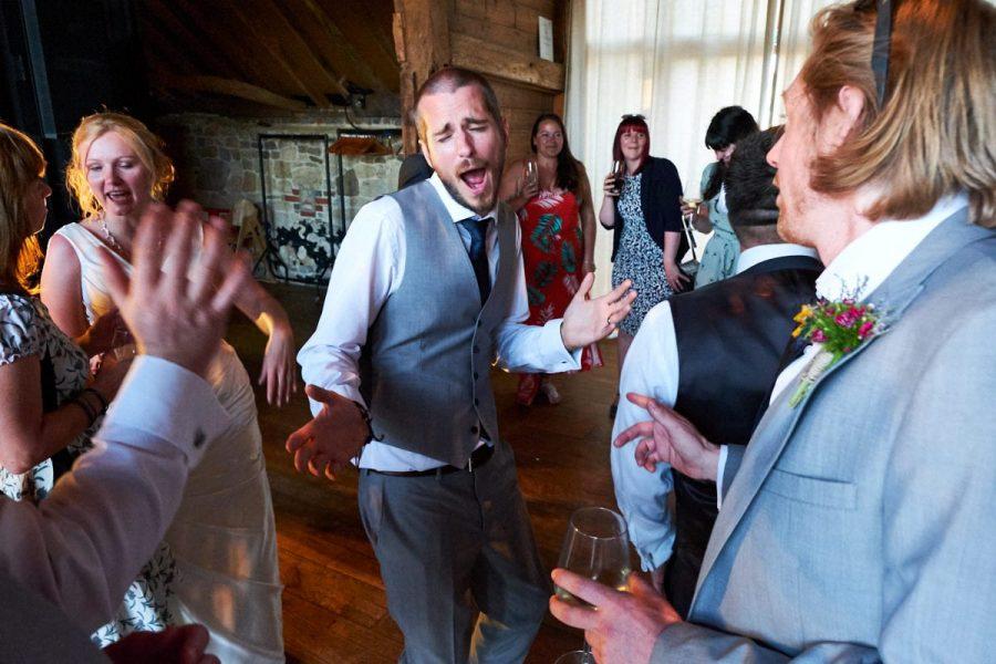 The groom singing