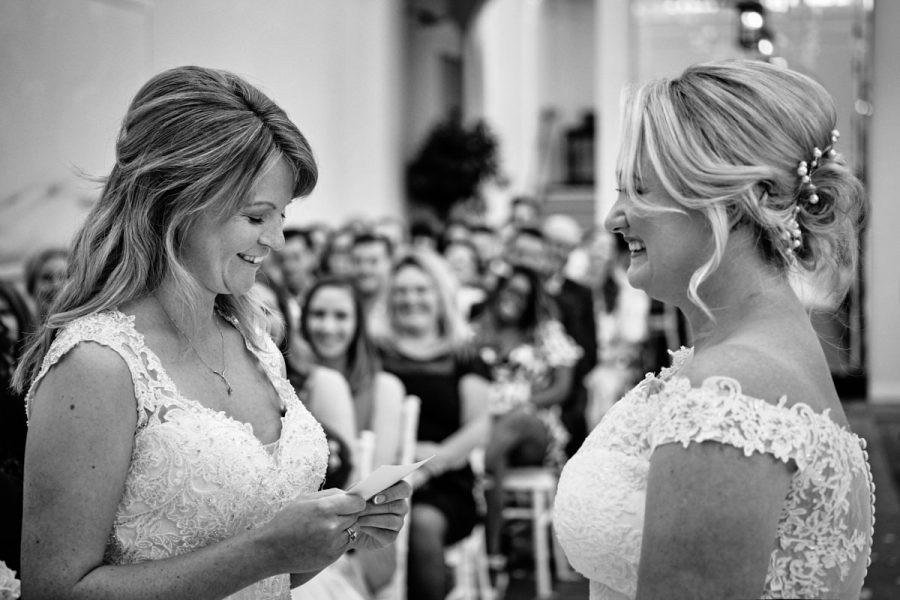 A bride reads her vows during the ceremony of her wedding at Buxted Park Hotel.