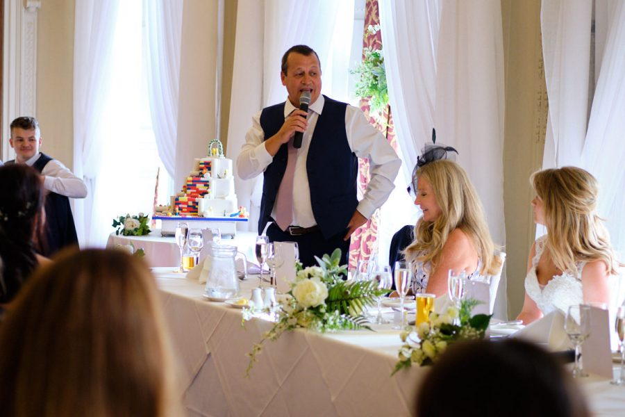 The father of the bride gives a speech at a wedding at Buxted Park Hotel in East Sussex.