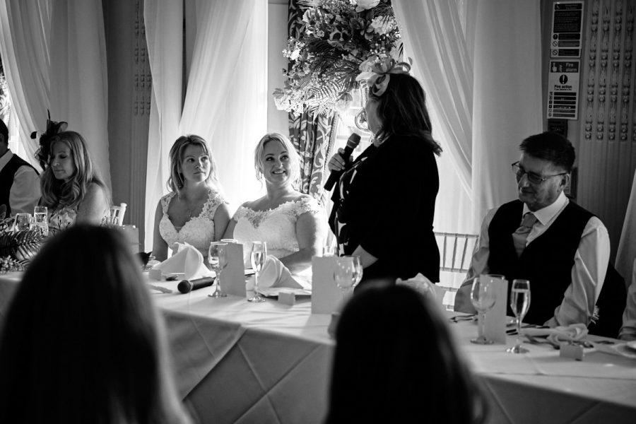 The mother of the bride gives a speech at a wedding.
